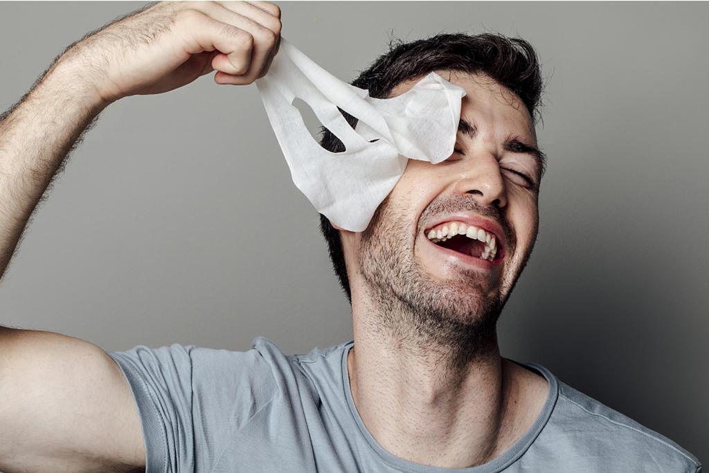 A man with a facial mask.